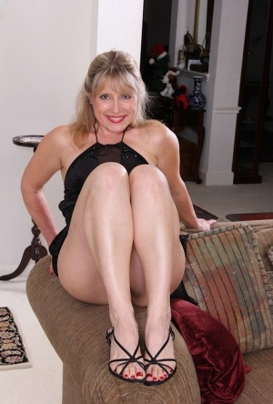 Middle aged amateur Rebecca Hill strips naked and masturbates with sex toy