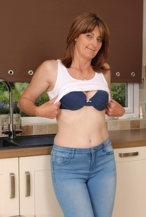 Mature housewife loses jeans and panties to masturbate on the kitchen floor