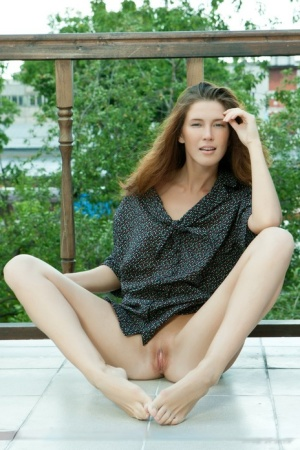 Hot brunette Kira J undressing on porch to spread legs for closeup pussy view