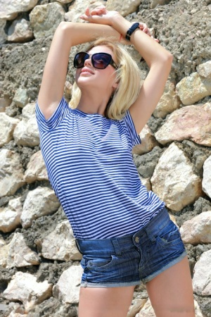 Young blonde Candy A shedding sunglasses and clothes in the forest