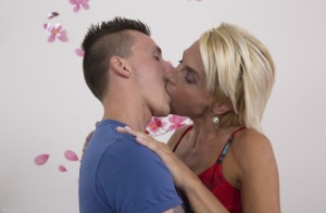 Short haired housewife finds her young boy toys attention to be intoxicating