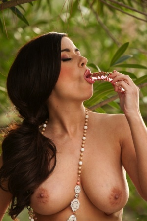 Solo girl Taylor Vixen toys her trimmed muff on the balcony