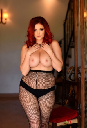 Rubenesque redhead Lucy V uncovers her nice tits in mesh pantyhose 77950596
