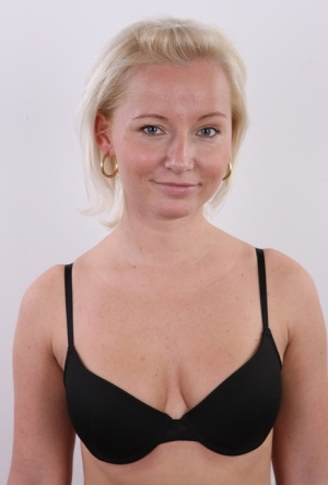 Blonde amateur Neli cracks a smile while launching her nude modeling career