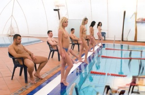 Gorgeous swimming sluts line up to suck hard cock in poolside groupsex