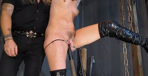 Females slave Abigail Dupree is tortured and spanked with hands above head