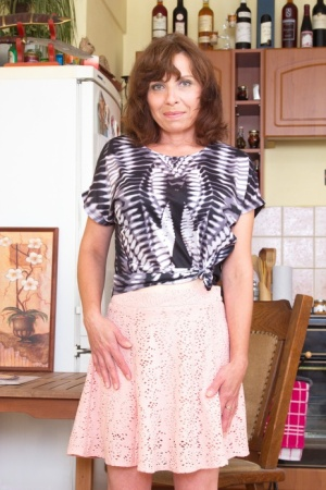 Horny mature mom slowly removes her clothes to fondle her small boobs nude