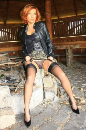 Clothed redhead Vixen Nylons displays hr upskirt panties in an abandoned barn