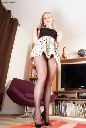 Solo model Lucy Lume shows off her long legs in crotchless pantyhose
