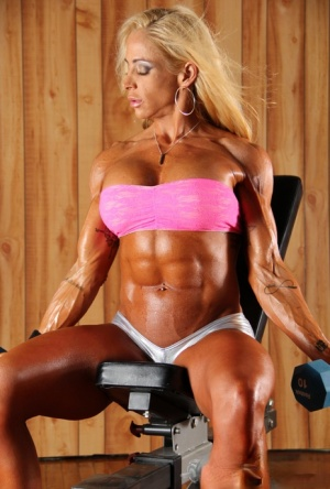Bodybuilder Jill Rudison poses her fit and bulging body at the gym