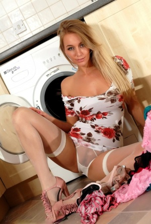 Blond chick Hayley Marie Coppin strips to back seam nylons doing her laundry