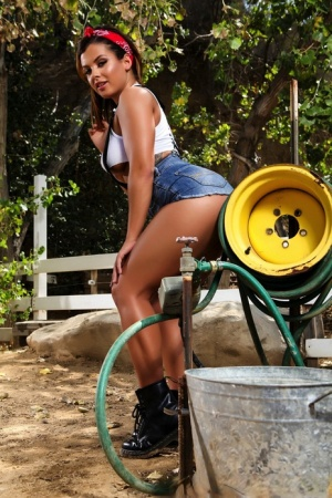 Busty hot pornstar Keisha Grey wets her great big tits and smokes on the farm 46374650