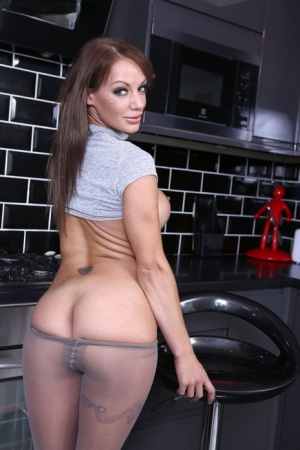 Hot MILF Lou Lou uncovers her huge tits before ripping open pantyhose 92937792