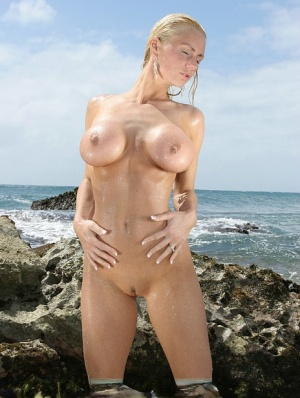 Natural blonde Naughty Allie frees her big tits and nice butt from bikini