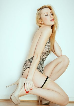 Fair skinned blond Sophia Smith works clear of a bodysuit and thong in hosiery