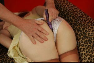 Ball gagged and bound redhead has her asshole stimulated by a vibrator