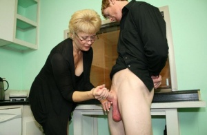 Fully clothed mature woman Tracy Lick jerks off her stepsons cock