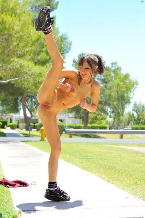 Fit teen Risi shows her pussy while working on kickboxing moves in the nude