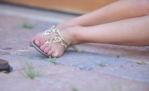 Dark haired teen strips to her sexy sandals up against a wooden door