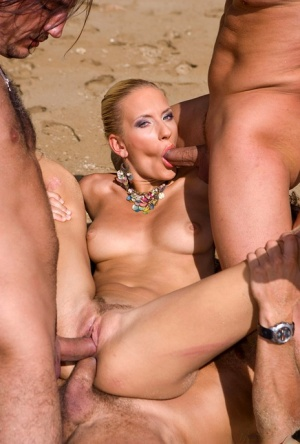 Leggy blonde chick gets triple fucked on a deserted beach