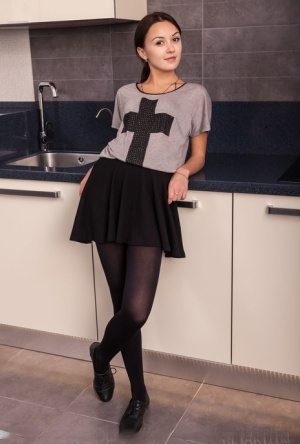 Clothed teen Veselin sheds hose and skirt to display flat chest and thin body