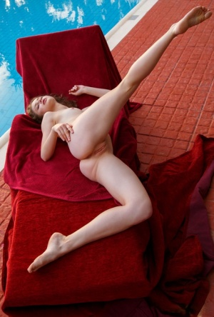 Beautiful blue eyed Clarice posing naked to show her shaved pussy up close
