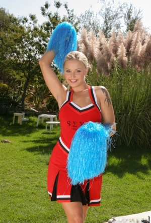 Cheerleader Liliane Tiger cheers nude outdoors  has her pierced pussy licked