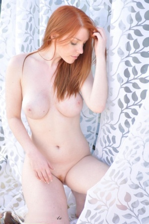 Pale redhead Fi Stevens poses stark naked to show off her beautiful big boobs 58702174