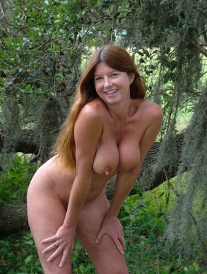 Middle aged lady Dee Delmar gets naked for nude posing underneath a tree 62310830