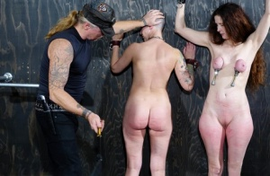 Female slaves Emma  Abigail Dupree get flogged while restrained in a dungeon