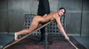 Submissive female London River is tied up with rope and spanked