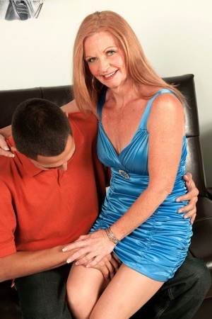 Hot granny with long hair seduces a younger man in a short dress
