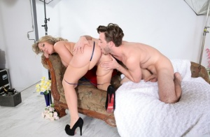 Busty chick Kiki Daire seduces her photographer during a boudoir shoot