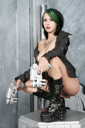 Futuristic babe Scarlet Starr sheds a leather jacket to get naked in boots