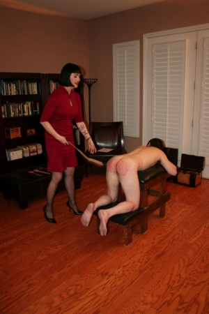 Dark-haired woman Snow Mercy paddles a naked mans ass while fully clothed 23645906