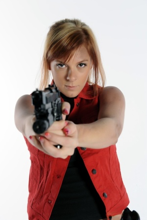 Solo girl Sophie wields a pistol while stripping to black boots