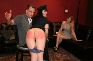 Brunette chick has her ass turned red while being spanked in front of her GF