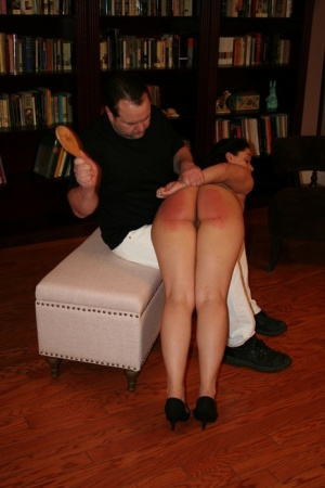 Naked brunette Mackenzie Reed has her ass turned red while being spanked