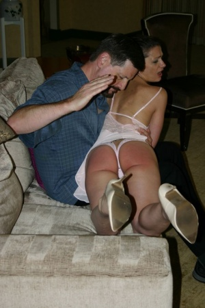 Bad girl Ten Amorette has her ass turned red while being spanked on a couch