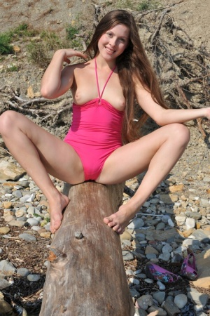 Solo girl shows her hairless pussy on a beach in the Ukraine