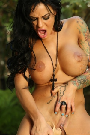 Inked Latina female Angelina Valentine rams a dildo up her cunt outside