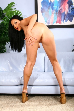 Dark haired chick Audrey Bitoni fingers her pussy after getting naked
