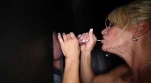 Naked blonde Gina gargles a mouthful of cum while at a gloryhole 17181502