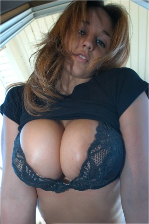 Amateur solo girl Nikki Sims shows her ample cleavage in a variety of bras