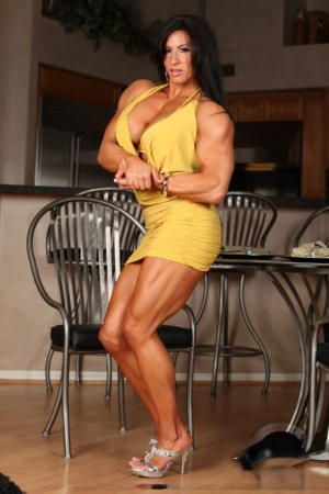 Female bodybuilder Angela Salvagno exposes her clit after pulling down a thong
