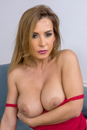 Hot busty Dorothy Black plays with nipples while masturbating in high heels