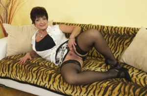 Plump housewife over 50 holds a large breasts while pleasing her snatch