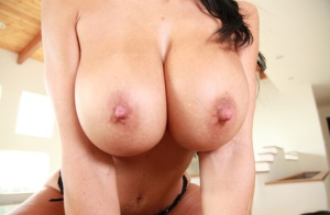 Big titted female Ava Addams plays with her hard nipples in black underwear