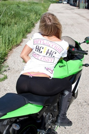 Amateur girl Meet Madden strips to her underwear on a motorcycle