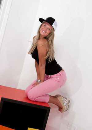 Dirty blonde amateur Kendra Rain takes off her ball cap before baring her tits